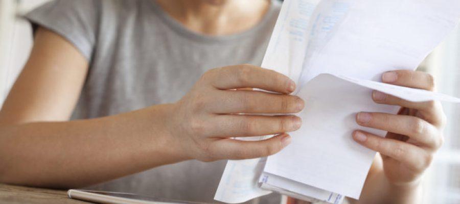 Amazed woman holding bills